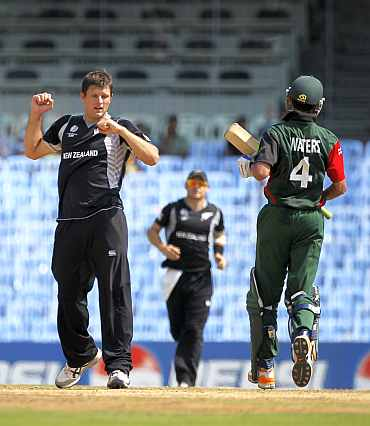 New Zealand's Hamish Bennett celebrates after picking up a Kenyan wicket