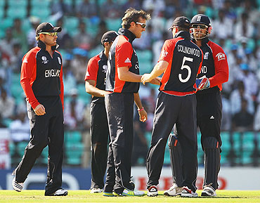 England's Graeme Swann is congratulated by teamamates after claiming the wicket of Wesley Barresi