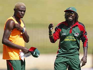Kenya's Nehemiah Odhiambo (R) teases teammate Elijah Otieno during a practice session