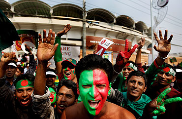 Bangladesh fans cheer outside the Shere-e-Bangla National Stadium in Dhaka prior to the World Cup opening match between Bangladesh and India on Saturday