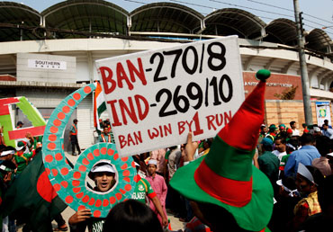 Optimistic Bangladesh fans queue to gain entry to the opening game of the World Cup between Bangladesh and India at the Shere-e-Bangla National Stadium on Saturday