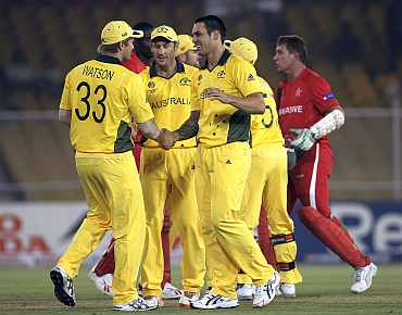 Australian players celebrate after winning the match against Zimbabwe in Ahmedabad
