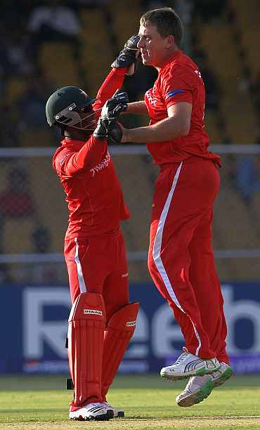 Zimbabwe's Raymond Price celebrates after picking up a wicket