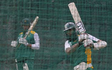 Hashim Amla (R) bats in the nets as his captain Graeme Smith watches