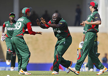 Kenya's Thomas Odoyo (centre) celebrates with teammates after dismissing Pakistan's Ahmed Shehzad