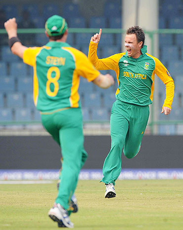 Johan Botha celebrates the wicket of Chris Gayle