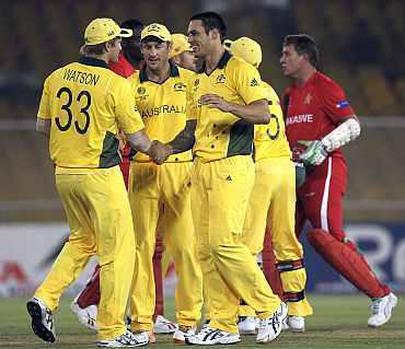 Australian Team celebrates after winning the match against Zimbabwe
