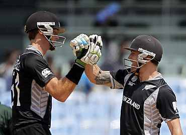 Brendon McCullum and Martin Guptill celebrate after winning their match against Kenya