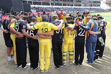 The New Zealand and Australian teams share a moment in support of victims of the earthquake