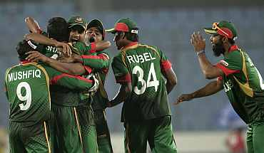 Bangladesh players celebrate after winning their match against Ireland