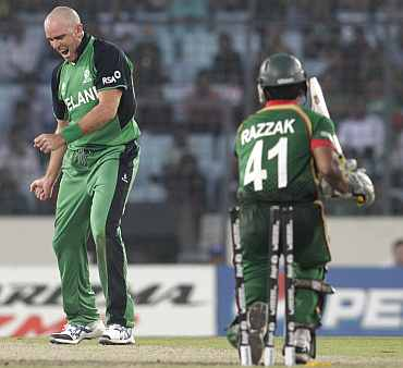Ireland's Trent Johnston (L) celebrates after dismissing Bangladesh's Abdur Razzak