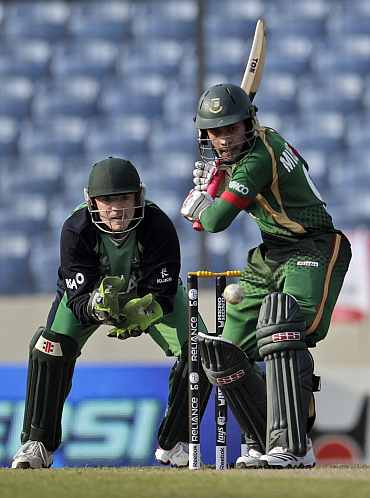 Bangladesh's Mushfiqur Rahim plays a shot as Ireland's wicketkeeper Niall O'Brien (L) watches