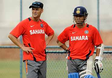 India's Sachin Tendulkar and coach Gary Kirsten during a practice session in Bangalore