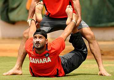 India's Harbhajan Singh stretches during a practice session in Bangalore