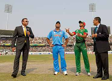 MS Dhoni during the toss in Dhaka