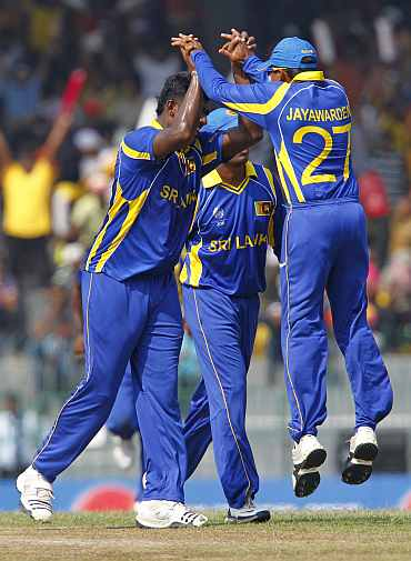 Sri Lankan players celebrate after picking up the wicket of Ahmed Shehzad