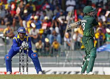 Pakistan's Kamran Akmal is stumped by Kumar Sangakkara