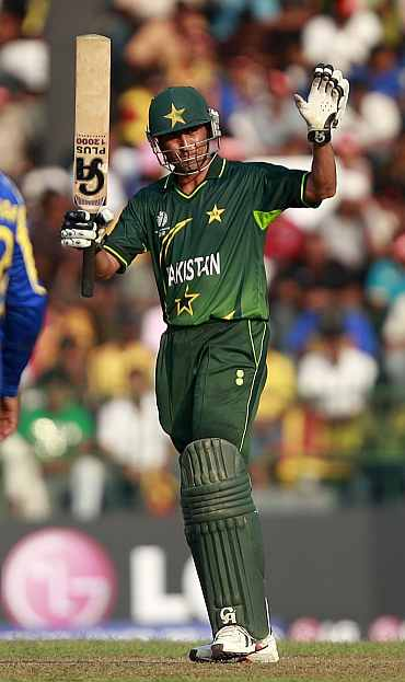 Younis Khan reacts after completing his half-century