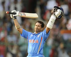 Sachin Tendulkar celebrates after getting to 100