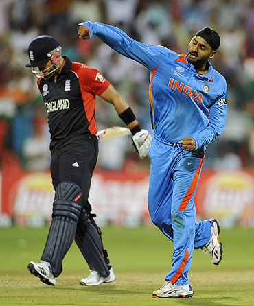 India's Harbhajan Singh (right) celebrates after dismissing England's Matt Prior