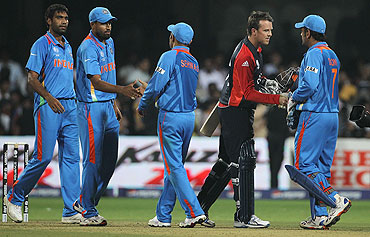 England's Graeme Swann greets Indian players after the match was tied