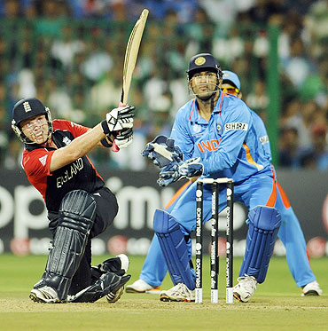 Ian Bell (left) hits a six off the bowling of Piyush Chawla