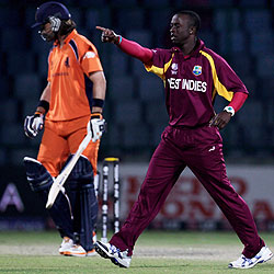 Kemar Roach celebrates after the dismissal of Bas Zuiderent