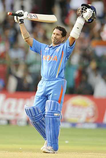 Sachin Tendulkar celebrates after reaching his century