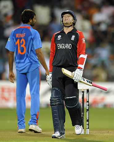 Graeme Swann reacts after missing out on a boundary