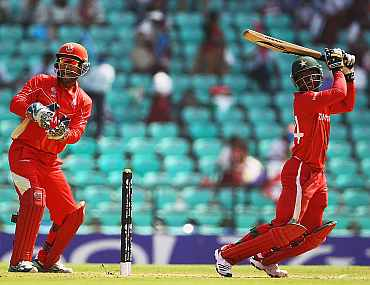Zimbabwe's Tatenda Taibu hits the ball towards the boundary during the World Cup Group A game between Canada and Zimbabwe