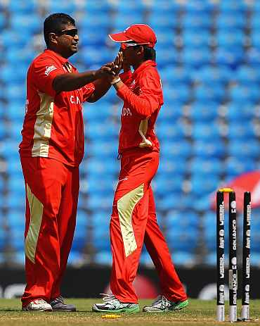 Canada's Balaji Rao is congratulated by Nitesh Kumar during the World Cup Group A game between Canada and Zimbabwe