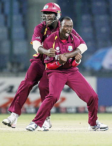 West Indies' Kemar Roach (right) celebrates with captain Darren Sammy after completing his hat-trick by dismissing Netherlands' Berend Westdijk
