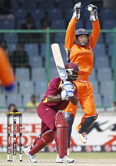 Netherlands' wicketkeeper Wesley Barresi appeals for the catch of West Indies' Devon Smith (left) off the bowling of Bernard Loots
