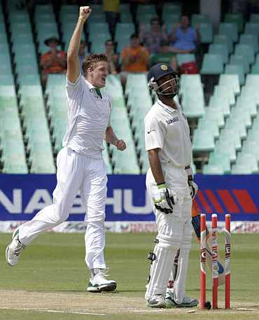 Chetershwar Pujara reacts after being bowled by Morne Morkel