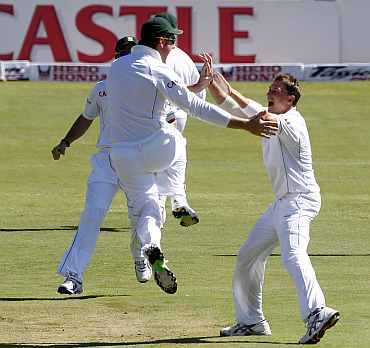 Graeme Smith celebrates with Dale Steyn after picking up a wicket