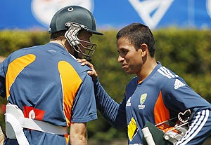 Australia's Usman Khawaja (right) and Michael Beer talk in the nets during a team practice session at the Sydney Cricket Ground on Sunday