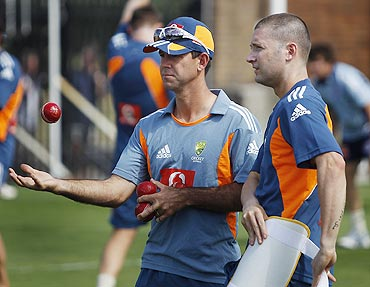 Australia's Michael Clarke and Ricky Ponting chat during a team practice session in Sydney