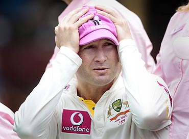 Australia's Michael Clarke reacts during a photo opportunity in support of the McGrath Foundation during a team practice session at the Sydney Cricket Ground on Sunday