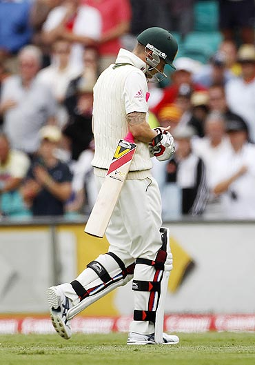 Australia's captain Michael Clarke walks off the field after being dismissed by Tim Bresnan on Monday