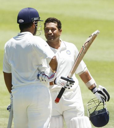 Tendulkar celebrates with M S Dhoni after getting to his hundred