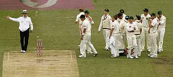 Umpire Billy Bowden signals no-ball after referring to the TV umpire the dismissal of Cook