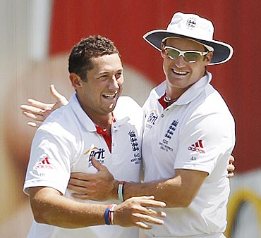 Andrew Strauss (right) congratulates Tim Bresnan for claiming the wicket of Hughes on Thursday