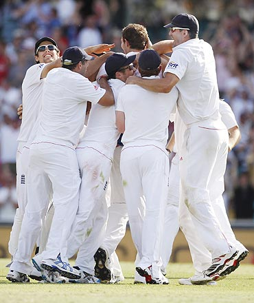 England players celebrate the dismissal of Mitchell Johnson on Thursday