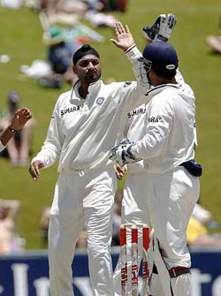 Harbhajan Singh celebrates with Mahendra Singh Dhoni