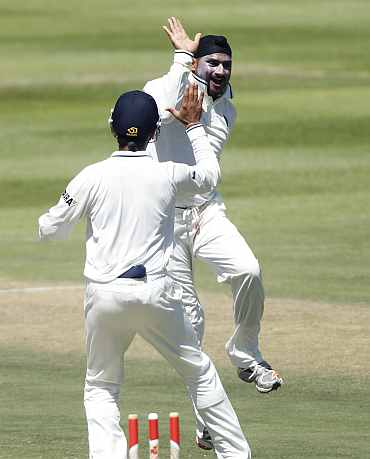 Harbhajan Singh celebrates after picking up a South African wicket at Newlands