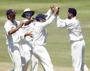 Harbhajan Singh celebrates after picking up Hashim Amla