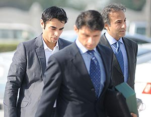 Salman Butt (left) arrives in Doha to record his statement