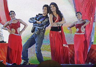 Bollywood actors Shah Rukh Khan and Priyanka Chopra perform at a show after the Twenty20 match between South Africa and India in Durban, on Sunday