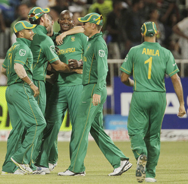 South Africa's JP Duminy, Graeme Smith, Lonwabo Tsotsobe, Johan Botha and Hashim Amla celebrate winning the one day international cricket match against India at Kingsmead Stadium in Durban