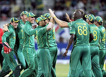 South Africa's JP Duminy (C) celebrates the wicket of India's Yuvraj Singh (not in picture) with teammates at Kingsmead